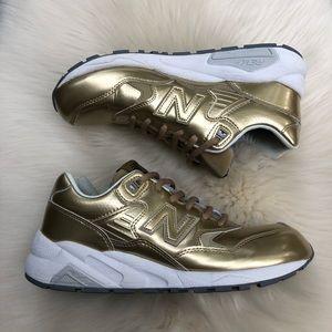 New Balance Women's Gold Metallic 580 Sneakers